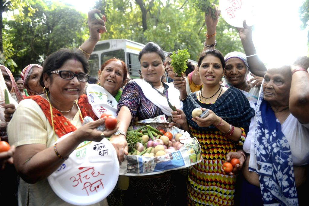 Mahila Congress activists protest on price rise Mahila Congress activists raising slogans during a demonstration near the BJP headquarters to protest against the price hike of commodities, ...