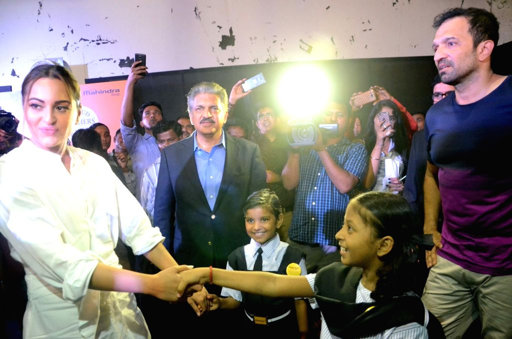 Mahindra Group chairman and managing director Anand Mahindra, actress Sonakshi Sinha and filmmaker Atul Kasbekar during the Project Nanhi Kali, the 'Proud Fathers For Daughters' initiative in ... - Anand Mahindra and Sonakshi Sinha