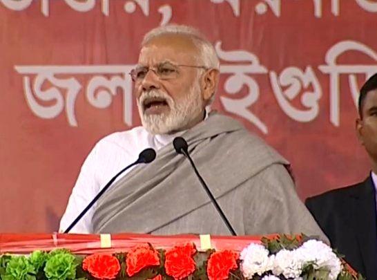 Mainaguri: Prime Minister Narendra Modi addresses during a public meeting in Mainaguri, West Bengal on Feb 8, 2019. (Photo: IANS/BJP) - Narendra Modi