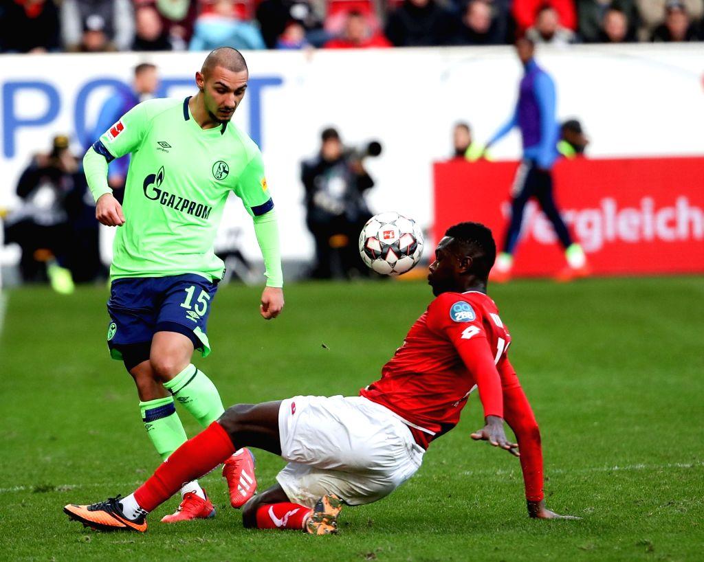 MAINZ, Feb. 24, 2019 - Achmed Kutucu (L) of Schalke 04 vies with Moussa Niakate of Mainz during the Bundesliga match between FSV Mainz 05 and FC Schalke 04 in Mainz, Germany, Feb. 23, 2019. Mainz won ...