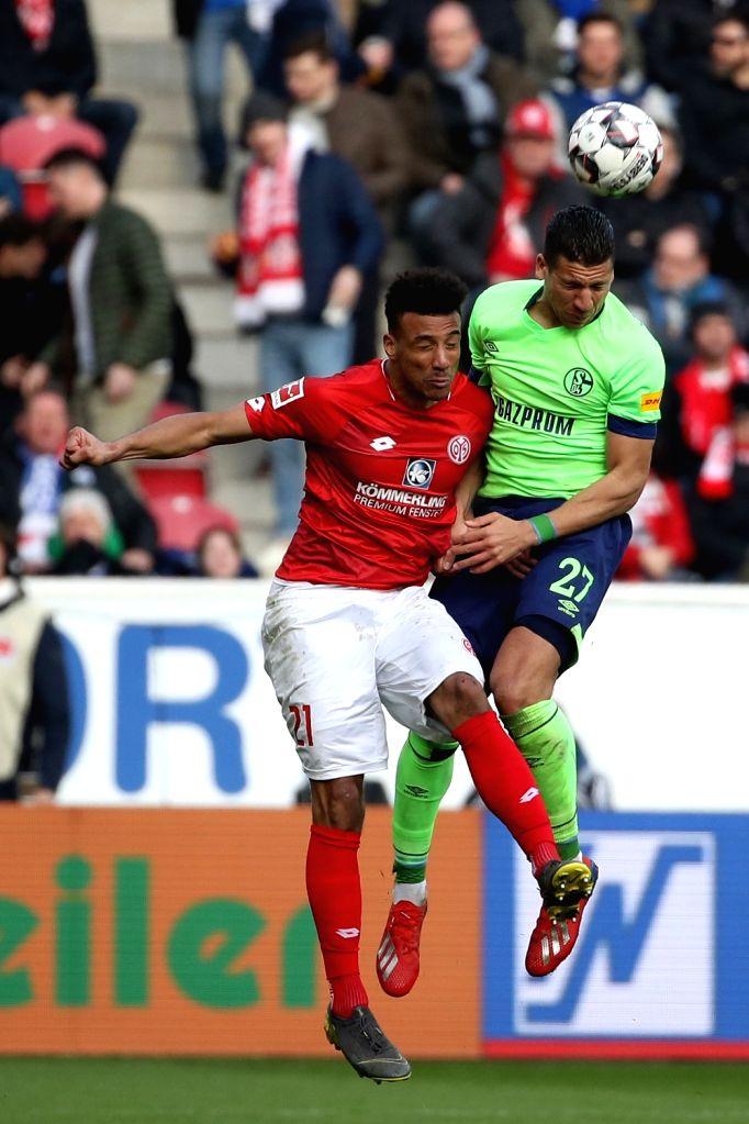 MAINZ, Feb. 24, 2019 - Karim Onisiwo (L) of Mainz vies for header with Jeffrey Bruma of Schalke 04 during the Bundesliga match between FSV Mainz 05 and FC Schalke 04 in Mainz, Germany, Feb. 23, 2019. ...