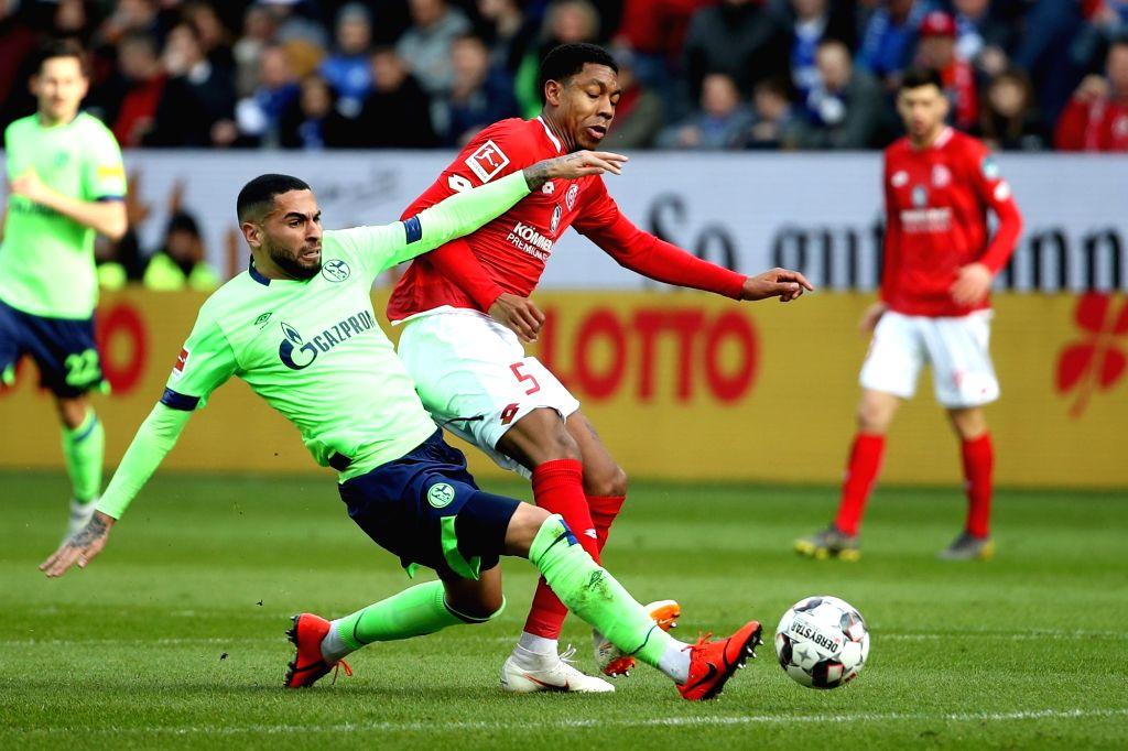 MAINZ, Feb. 24, 2019 - Omar Mascarell (front L) of Schalke 04 vies with Jean-Paul Boetius of Mainz during the Bundesliga match between FSV Mainz 05 and FC Schalke 04 in Mainz, Germany, Feb. 23, 2019. ...