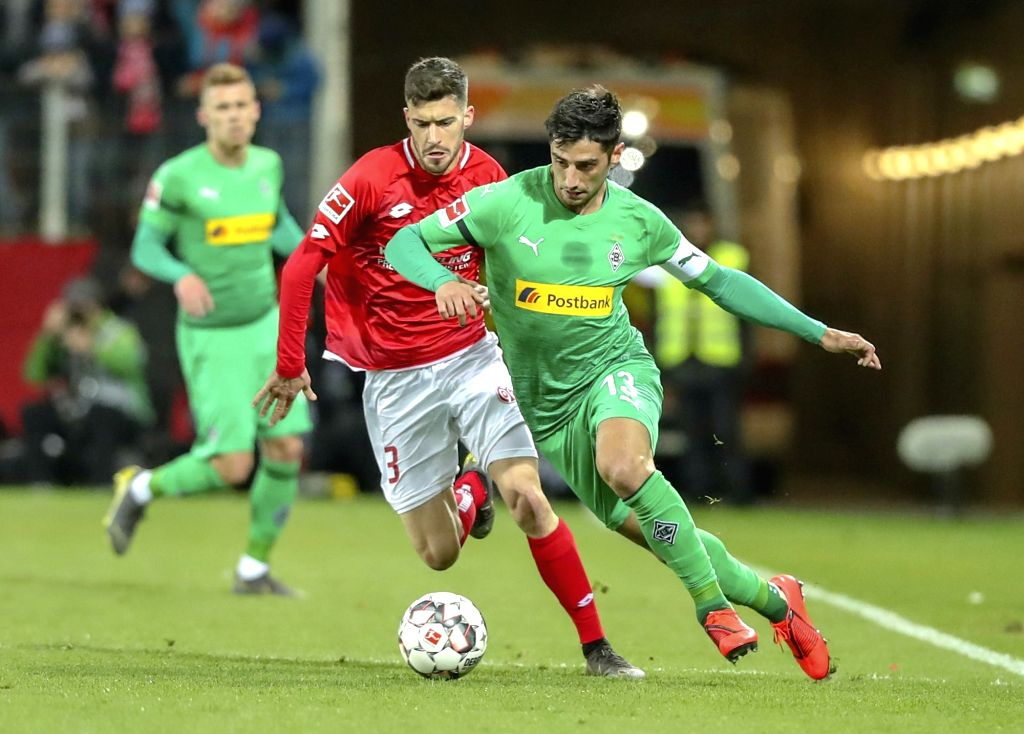 MAINZ, March 10, 2019 - Lars Stindl (R) of Moenchengladbach vies with Aaron Martin of Mainz during the Bundesliga match between FSV Mainz 05 and Borussia Moenchengladbach in Mainz, Germany, March 9, ...