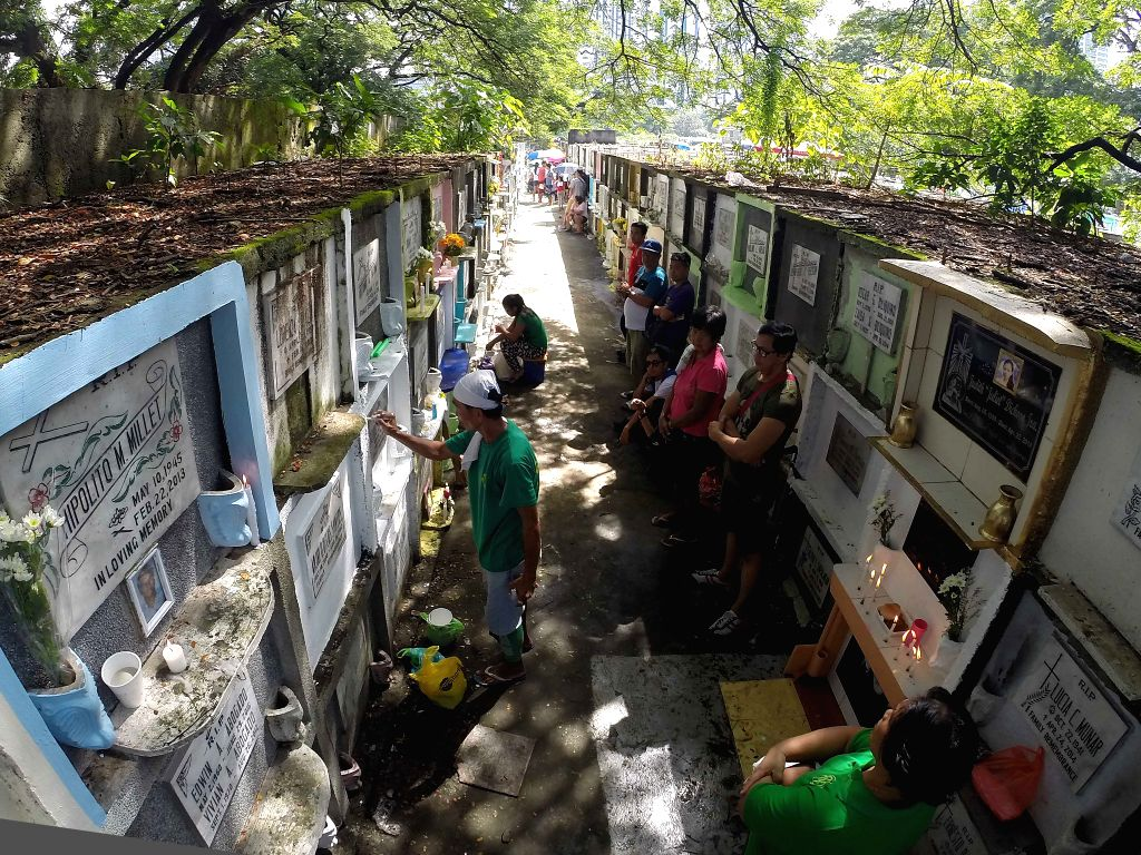 MAKATI CITY, Nov. 1, 2016 - People visit tombs of their relatives in Makati City, the Philippines, Nov. 1, 2016. Millions of people paid tribute to the dead by visiting tombs of their deceased ...