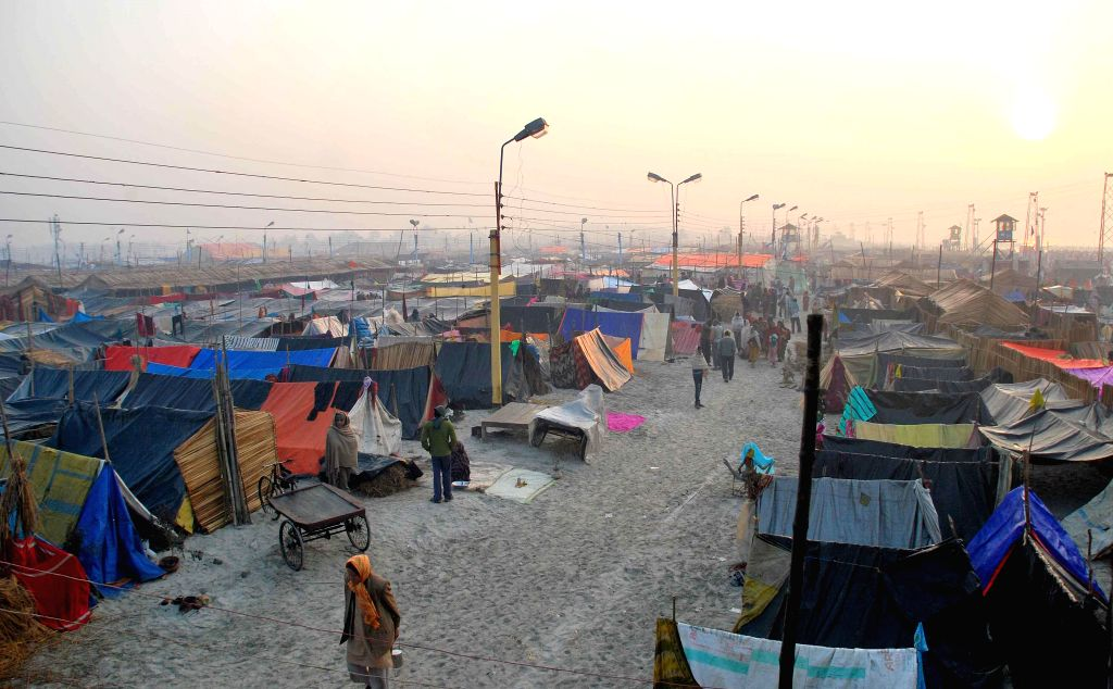 Makeshift tents come up at the Gangasagar island to accommodate pilgrims on the island a day ahead of Makar Sankranti some 160 kms south of Kolkata on Jan 13, 2015.