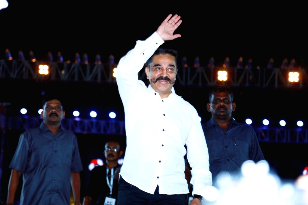 Makkal Needhi Maiam chief Kamal Haasan waves at supporters during a public meeting in Tiruchirappalli on April 4, 2018.