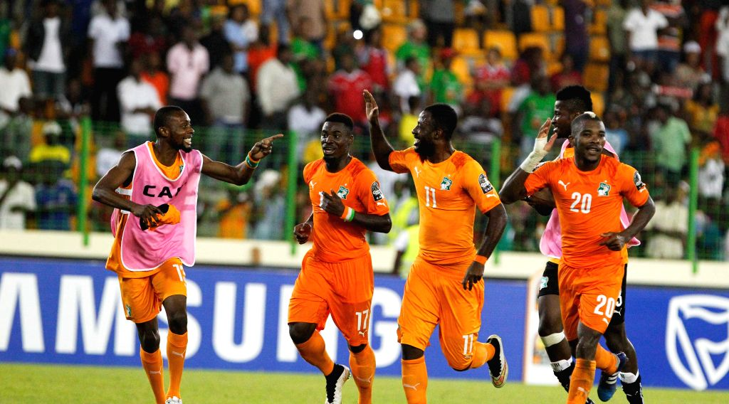 Players of Cote d'Ivoire celebrate after winning the quarterfinal match of Africa Cup of Nations against Algeria in Malabo, Equatorial Guinea, Feb. 1, 2015. Cote ...