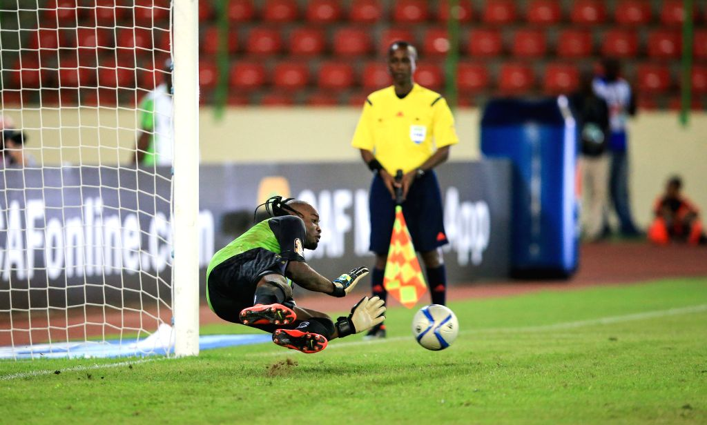 Robert Kidiaba Muteba, goalkeeper of the Democratic Republic of Congo (DR Congo), saves a penalty kick during the third place play-off match with Equatorial Guinea at