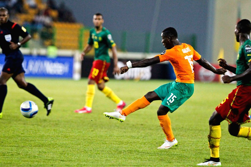 Max Alain Gradel of Cote d'Ivoire shoots to score during the group match of Africa Cup of Nations against Cameroon at the Stadium of Malabo, Equatorial Guinea, Jan. .