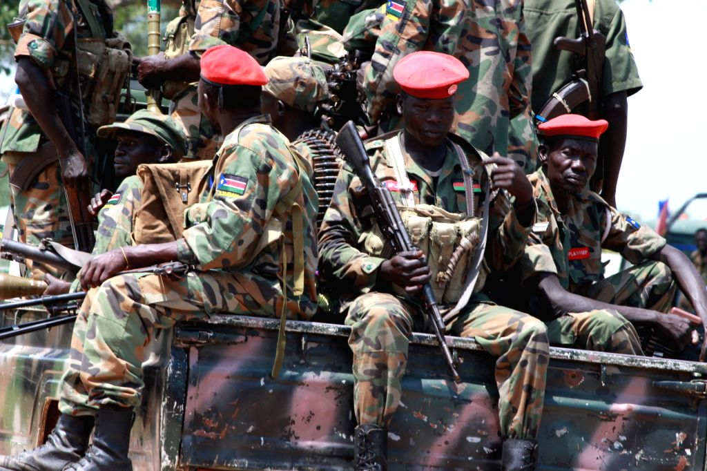 MALAKAL, Oct. 17, 2016 - Photo taken on Oct. 16, 2016 shows South Sudan's government troops patrolling in Malakal town, South Sudan. Fresh clashes between government and opposition forces near the ...