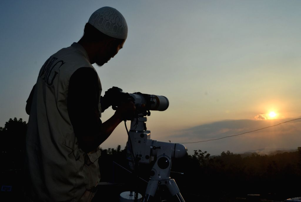 MALANG, July 5, 2016 - A Muslim man observes the position of the moon with a telescope to determine the end of the month of Ramadan as well as the first day to celebrate Eid al-Fitr festival in ...