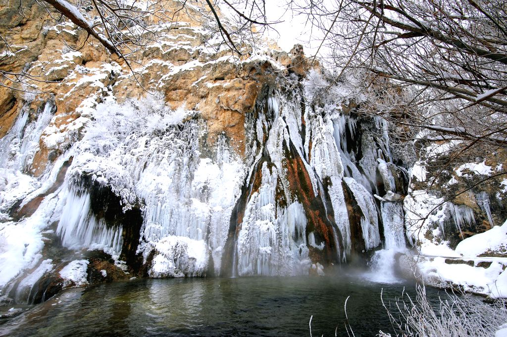 MALATYA, Jan. 22, 2019 - Photo taken on Jan. 21, 2019 shows the frozen Gunpinar Waterfall in Malatya province of eastern Turkey. The waterfall with a height of over 40 meters is frozen almost every ...