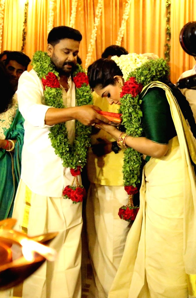 Malayalam actors Dileep and Kavya Madhavan during their wedding ceremony in Kochi on Nov 25, 2016. Dileep was previously married to actress Manju Warrier, while Kavya got separated from NRK ... - Manju Warrier, Dileep and Kavya Madhavan