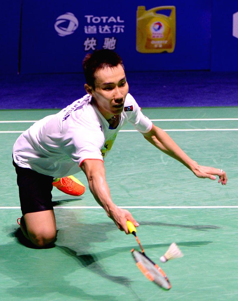 Malaysia's Lee Chong Wei returns the shuttlecock during the men's singles final match against Chen Long of China at 2015 Badminton China Open in Fuzhou, southeast ...