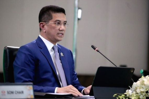 Malaysia's Minister of International Trade and Industry Mohamed Azmin Ali speaks during the virtually-held Asia-Pacific Economic Cooperation (APEC) Ministerial Meeting in Kuala Lumpur, Malaysia, Nov. ...