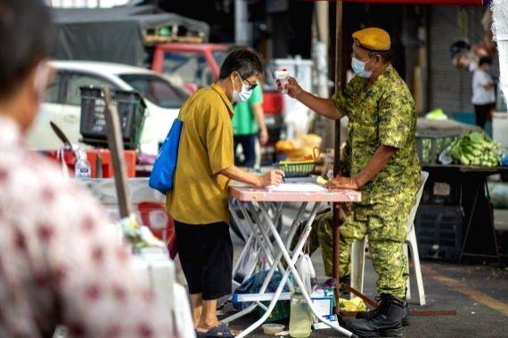 Malaysia tightens restrictions amid resurgence