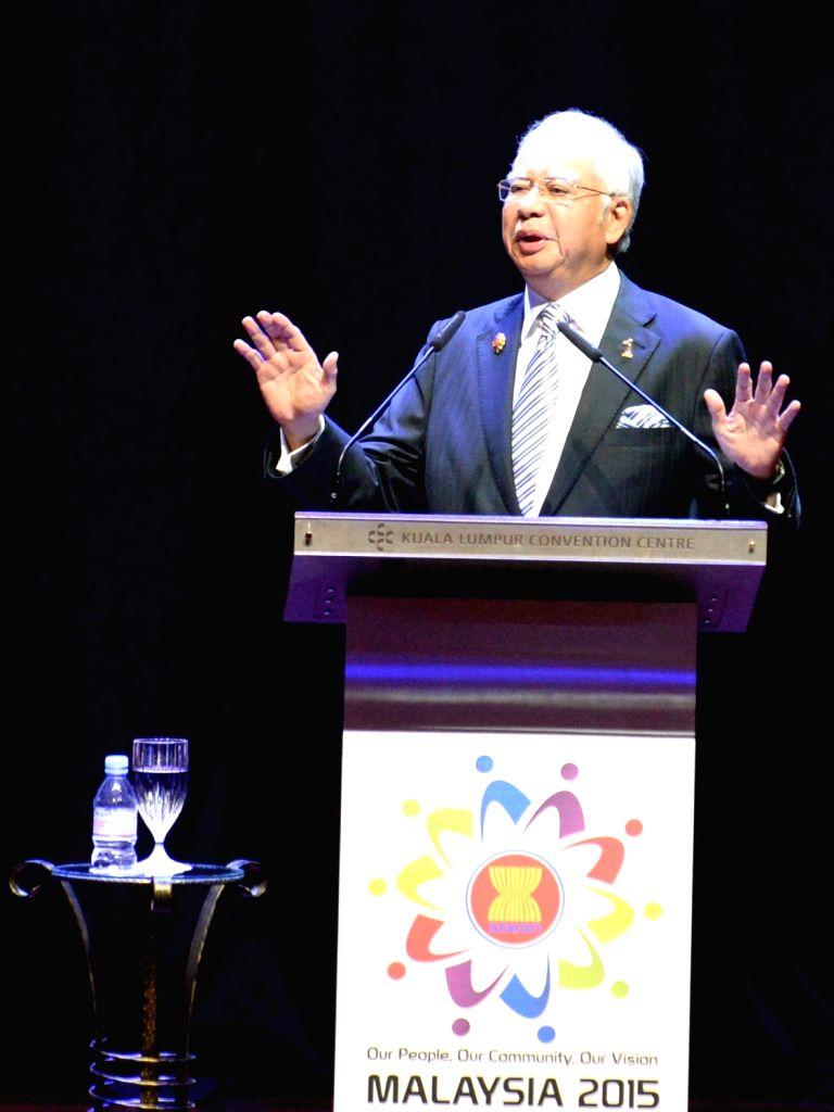 :Malaysian Prime Minister Najib Razak addresses the opening ceremony of the 27th summit of the Association of Southeast Asian Nations (ASEAN), in Malaysian ... - Najib Razak