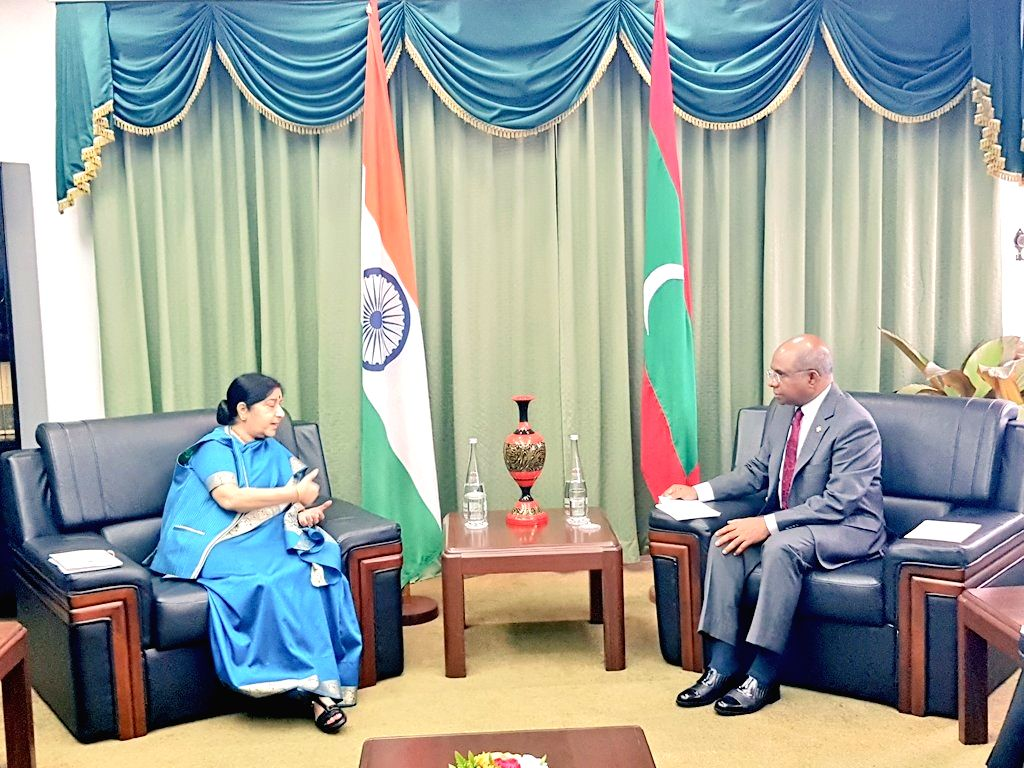 Maldives: External Affairs Minister Sushma Swaraj being received by Maldives Foreign Minister Abdulla Shahid ahead of the bilateral talks and Joint Ministerial meeting in Maldives on March ... - Sushma Swaraj