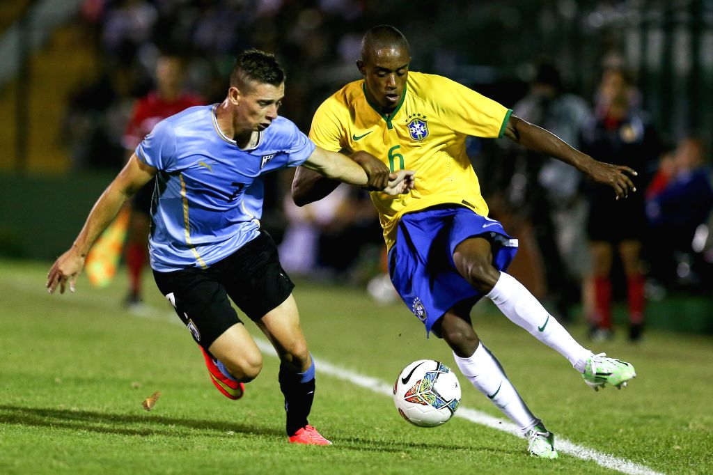 Uruguay's Facundo Castro (L) vies with Brazil's Cajo during the South American U-20 football match between Uruguay and Brazil in Maldonado, Uruguay, Jan. 17, ...