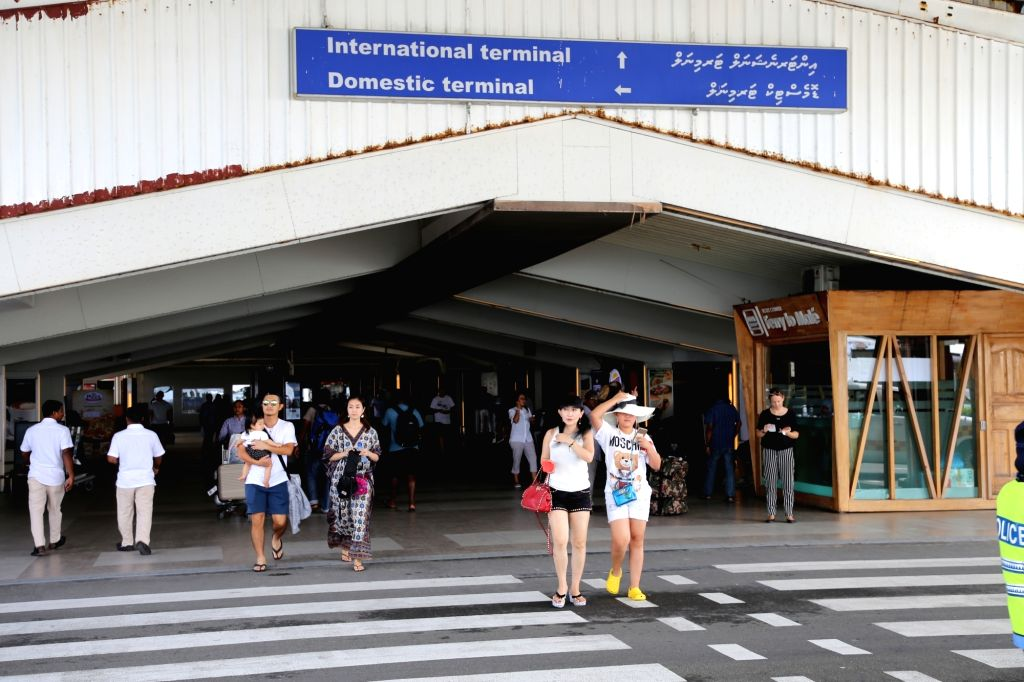 MALE, Feb. 7, 2018 - Tourists walk out of the airport in Male, Maldives, Feb. 7, 2018. Maldivian President Abdulla Yameen on Monday evening declared a state of emergency amid political crisis in the ...