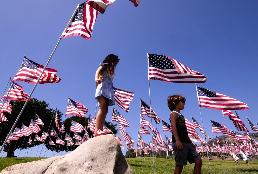 MALIBU, Sept. 11, 2018 - Children play among U.S. national flags erected to honor the victims of the September 11, 2001 attacks in New York, at the campus of Pepperdine University in Malibu, the ...