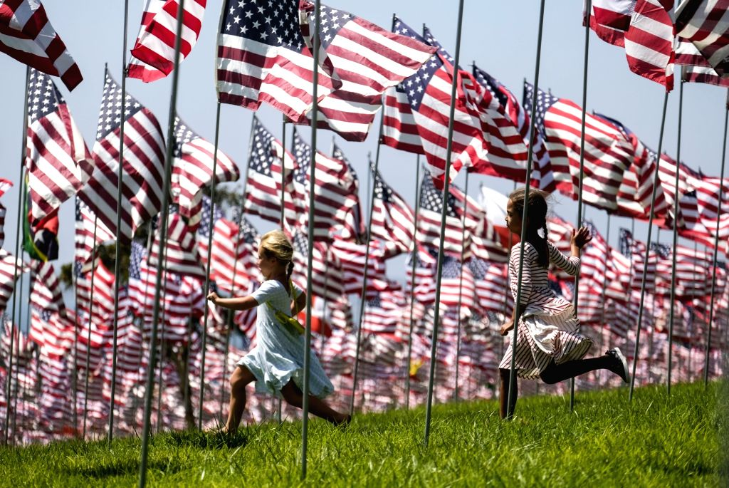 MALIBU, Sept. 11, 2018 - Children run among U.S. national flags erected to honor the victims of the September 11, 2001 attacks in New York, at the campus of Pepperdine University in Malibu, the ...