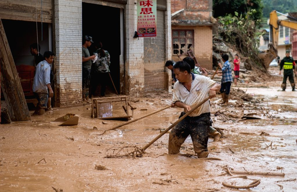 MALIPO, Sept. 3, 2018 - People clear the mud at flood-hit Mengdong Township in Malipo County of Zhuang and Miao Autonomous Prefecture of Wenshan, southwest China's Yunnan Province, Sept. 3, 2018. ...