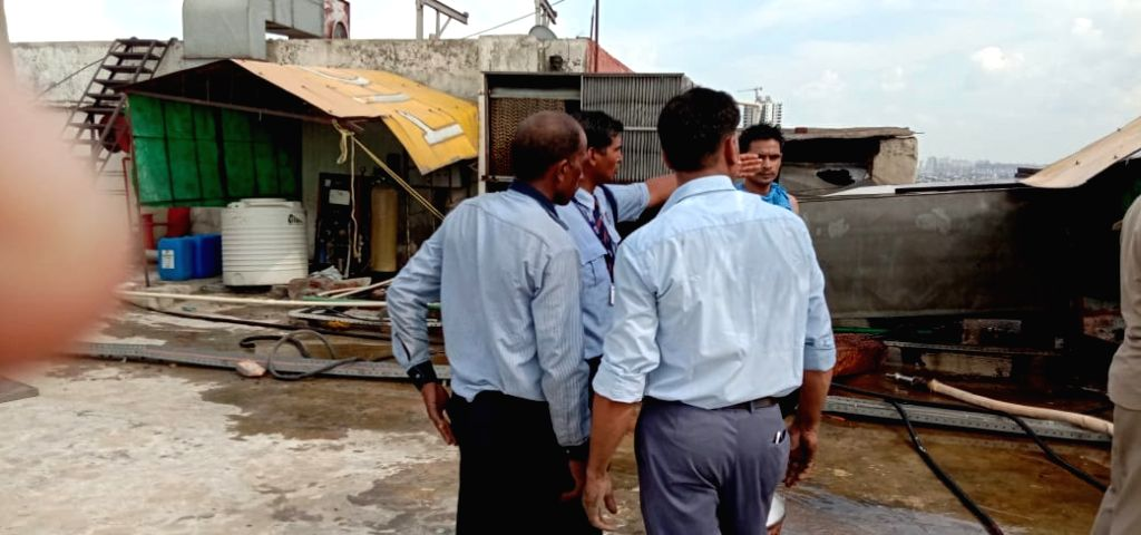 Mall authority officials at the Spice Mall where a major fire broke out in Noida Sector 25, on Aug 26, 2019. No casualties have been reported.