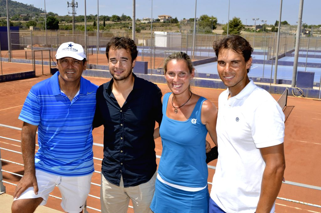 "Spanish tennis player Rafael Nadal (1st,R) poses during the presentation of the facilities that will be the ""Centre Tenis and Panel"", at Manacor ..."