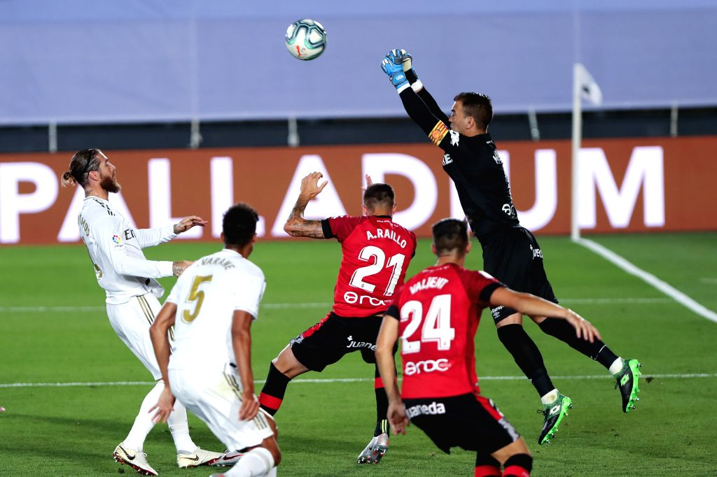 Mallorca's goalkeeper Manolo Reina (1st R) competes during a Spanish league football match between Real Madrid and Mallorca in Madrid, Spain, June 24, 2020.