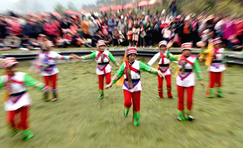 MALONG, Feb. 28, 2017 - People of Yi ethnic group perform to celebrate Er Yue Er, or the second day of the second month on the Chinese Lunar calendar in Zika Village of Malong County, southwest ...