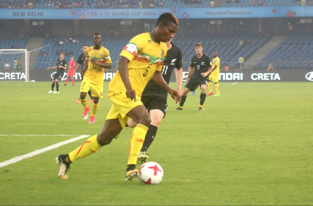 Mamadi Fofana (Yellow Jersey No-5) of Mali of New Zealand in action during a FIFA U-17 World Cup Group A match between Mali and New Zealand at Jawaharlal Nehru Stadium in New Delhi on Oct ...