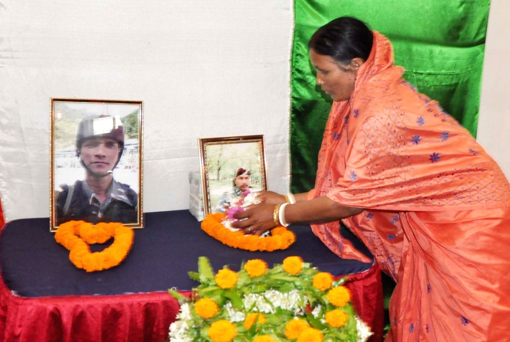 Mamata Biswas, mother of Late Sudip Biswas, a CRPF trooper from West Bengal, who was killed in the Pulwama terror attack, pays homage to her son during a programme organised on the 54th ...