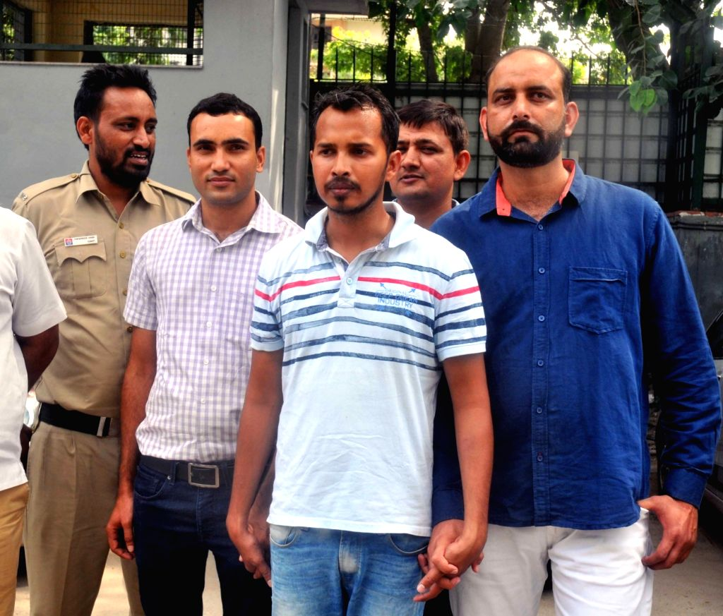 Man involved in extortion case of Rs 5 crores in the custody of Crime branch officials at Police Headquarters in New Delhi on Sept 12, 2017.