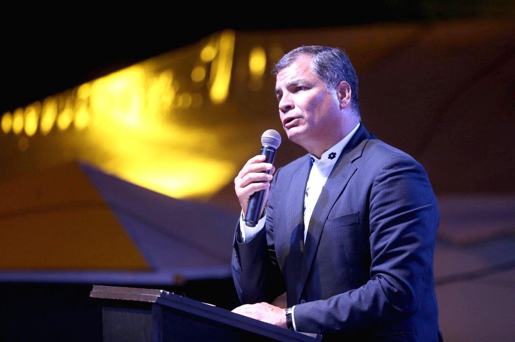 MANABI, April 17, 2017 - Ecuadorian President Rafael Correa delivers a speech during an open-air mass in the town of Pedernales, Manabi province, Ecuador, on April 16, 2017. Ecuador held an open-air ...