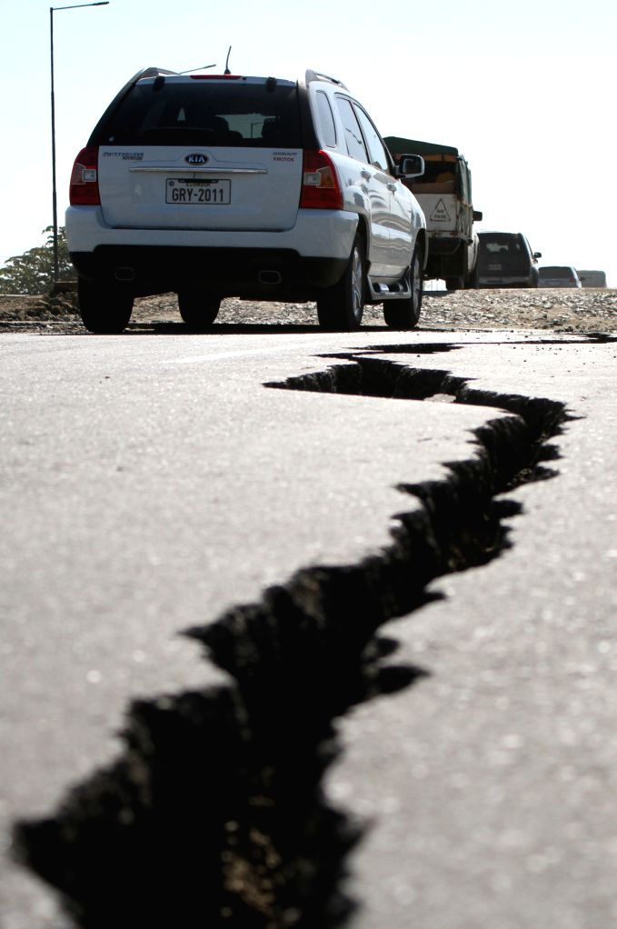 MANABI (ECUADOR), April 20, 2016 A crack caused by the earthquake is seen on a street in Bahia de Caraquez, province of Manabi, Ecuador, on April 19, 2016. The death toll from Saturday's ...
