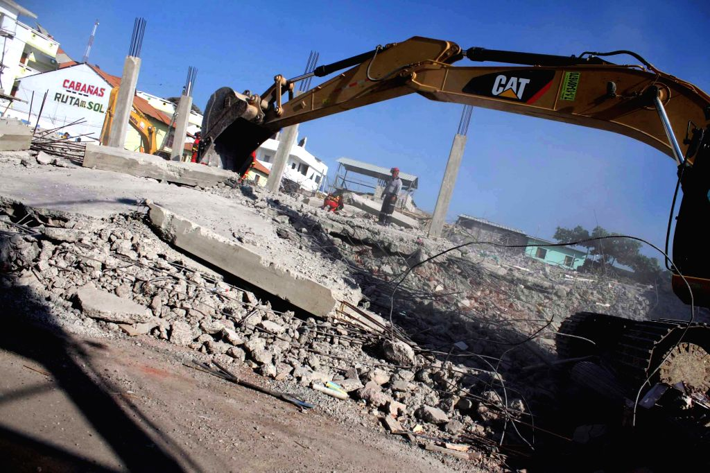 MANABI (ECUADOR), April 20, 2016 An excavator removes debris of a hotel after the earthquake in Canoa, province of Manabi, Ecuador, on April 19, 2016. The death toll from Saturday's ...