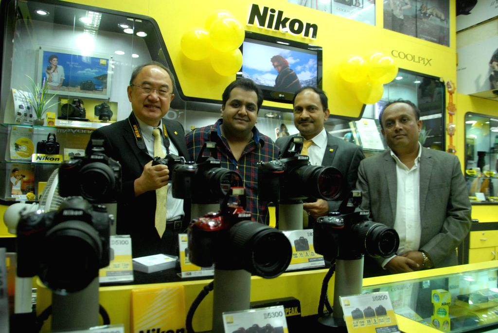 Managing Director of Nikon India Ltd Hiroshi Takashina with Nikon dealers in Mumbai on Sept 10, 2014.