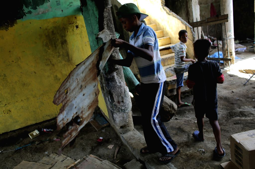 Children stay inside an affected structure after Sunday's earthquake in Managua, capital of Nicaragua, on April 14, 2014. Two earthquakes, measuring 4.4 and 5.6 ...