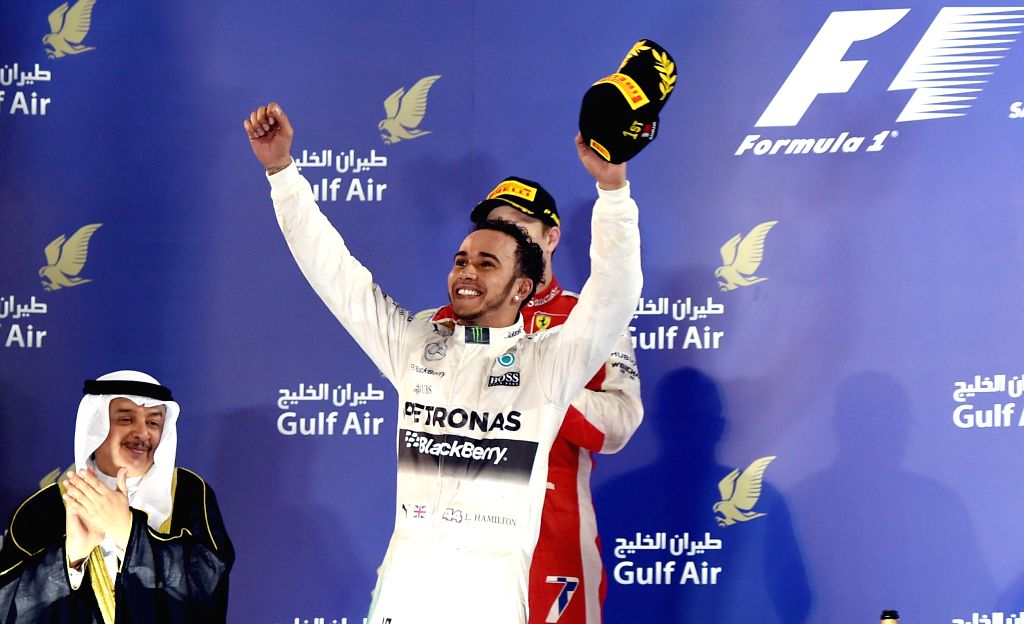 Mercedes Formula One driver Lewis Hamilton of Britain celebrates on the podium after F1 Grand Prix at Bahrain International Circuit, south of Manama, April 19, ...