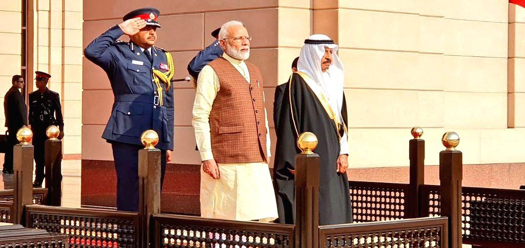 Manama: Prime Minister Narendra Modi with Bahrain Prime Minister Khalifa bin Salman Al Khalifa, during a ceremonial welcome accorded to him at Al Gudaibiya Palace in Manama, Bahrain on Aug 24, 2019. (Photo: IANS/MEA) - Narendra Modi