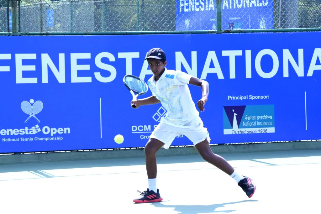 Manas M Dhamne in action against Aryan Aroram in Boys U-14 category of the Fenesta Open Junior National Tennis Championship, in New Delhi on Oct 9, 2019.