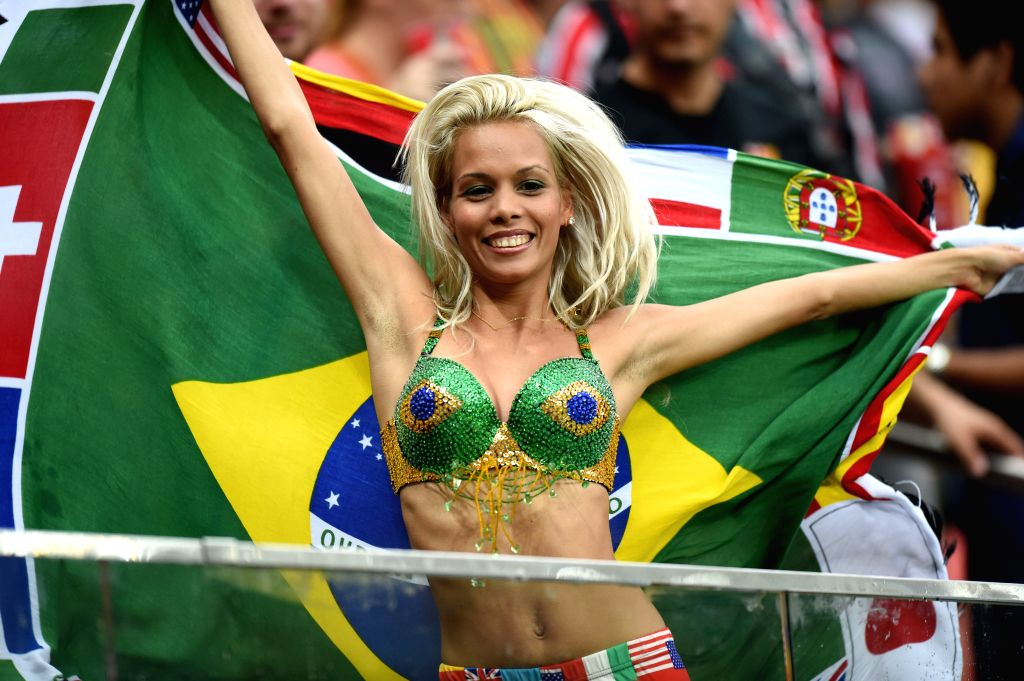 A fan poses before a Group A match between Cameroon and Croatia of 2014 FIFA World Cup at the Arena Amazonia Stadium in Manaus, Brazil, June 18, 2014.Photo: ...