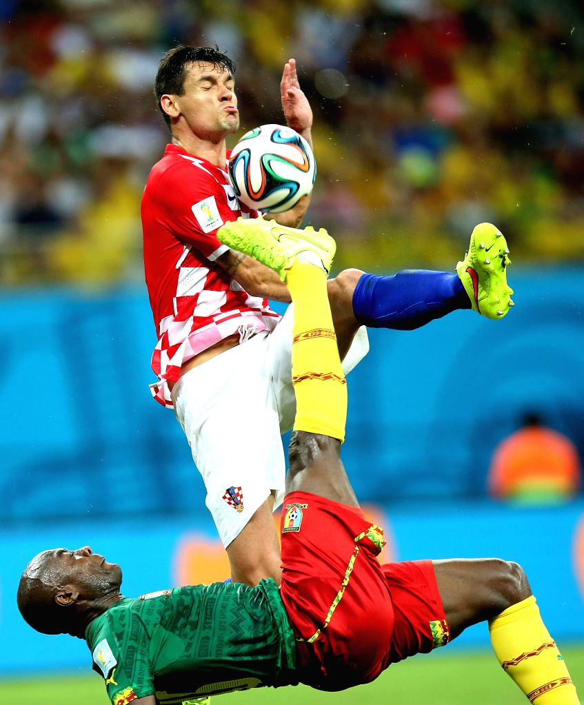 Cameroon's Achille Webo makes an overhead kick during a Group A match between Cameroon and Croatia of 2014 FIFA World Cup at the Arena Amazonia Stadium in Manaus, ...