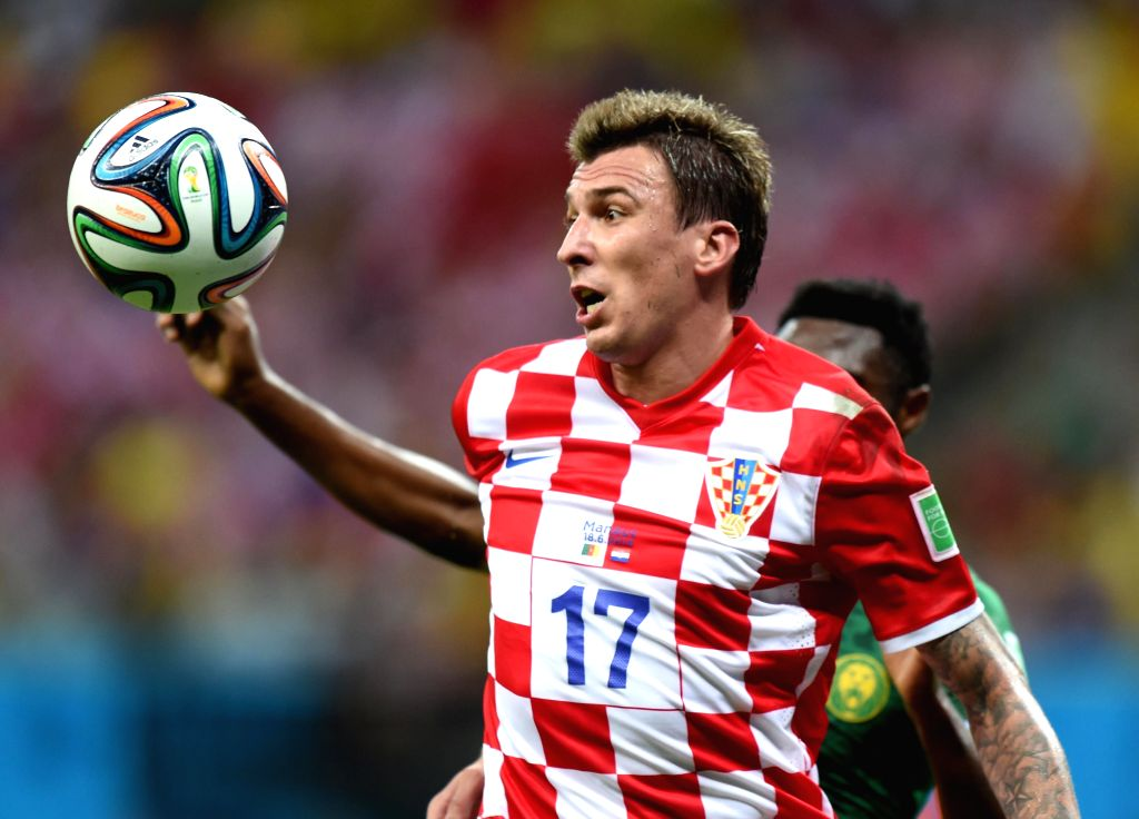 Croatia's Mario Mandzukic competes to gain control of the ball during a Group A match between Cameroon and Croatia of 2014 FIFA World Cup at the Arena Amazonia ...