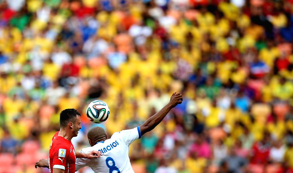 Honduras' Wilson Palacios (R) competes for a header with Switzerland's Josip Drmic during a Group E match between Honduras and Switzerland of 2014 FIFA World Cup at .