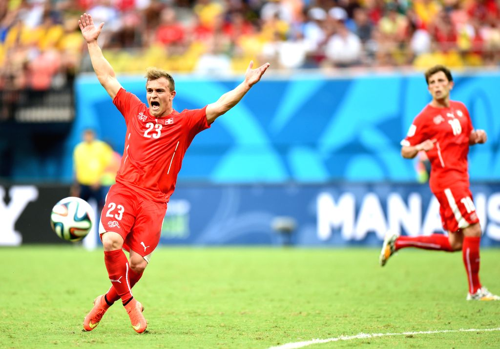 Switzerland's Xherdan Shaqiri (L) reacts during a Group E match between Honduras and Switzerland of 2014 FIFA World Cup at the Arena Amazonia Stadium in Manaus, ...