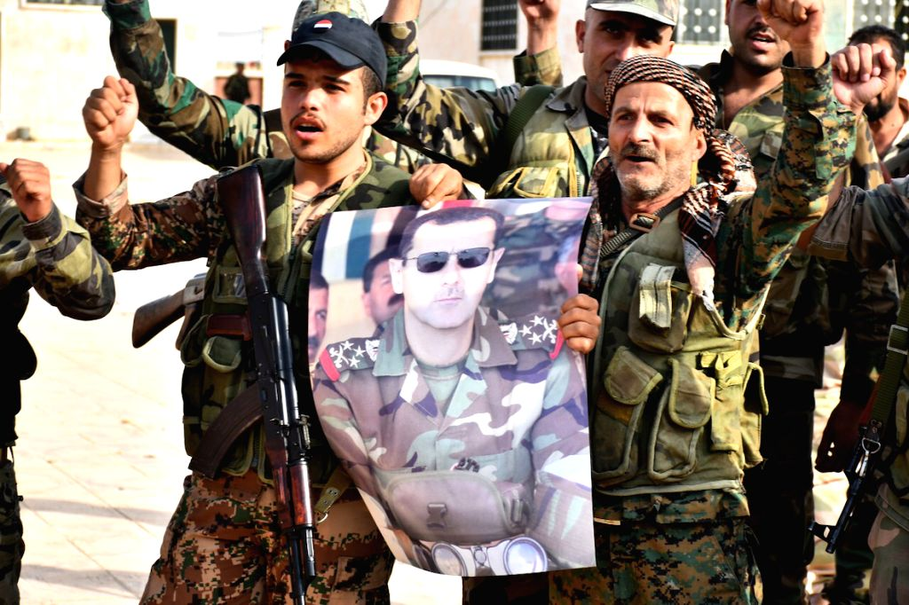 MANBIJ, Oct. 16, 2019 - Syrian soldiers are seen celebrating while holding a poster of President Bashar al-Assad inside a military base in the city of Manbij in northern Syria on Oct. 15, 2019. The ...