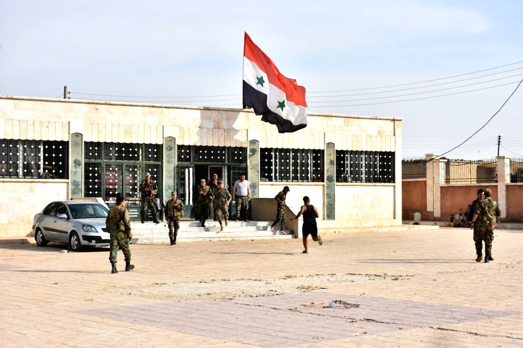 MANBIJ, Oct. 16, 2019 - Syrian soldiers are seen inside a military base in the city of Manbij in northern Syria on Oct. 15, 2019. The Syrian army assumed full control over Manbij on Tuesday, days ...
