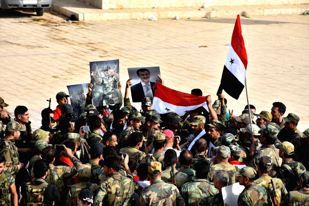 MANBIJ, Oct. 16, 2019 - Syrian soldiers are seen celebrating inside a military base in the city of Manbij in northern Syria on Oct. 15, 2019. The Syrian army assumed full control over Manbij on ...